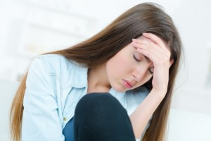 woman with head pain at home